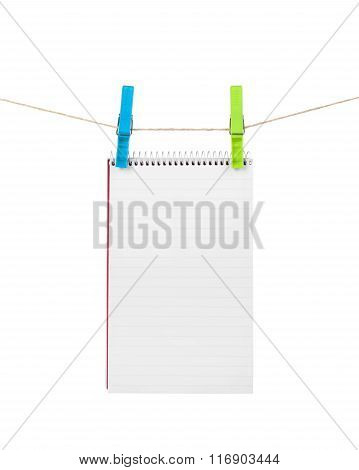Exercise Book On A Rope Isolated On White