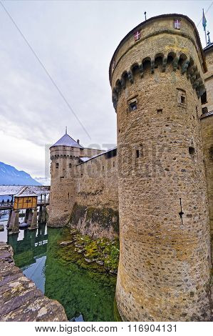 Front Towers Of Chillon Castle On Lake Geneva Of Switzerland