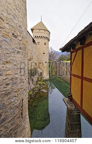 VEYTAUX SWITZERLAND - JANUARY 2 2015: Tower of Chillon Castle. It is an island castle on Lake Geneva (Lac Leman) in the Vaud canton between Montreux and Villeneuve.