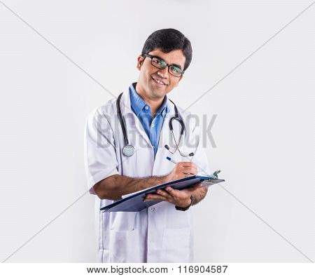 indian male doctor with writing pad or medical chart, asian doctor with medical chart or writing pad