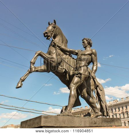 Sculpture Of A Man With A Horse Next To Anichkov Bridge.