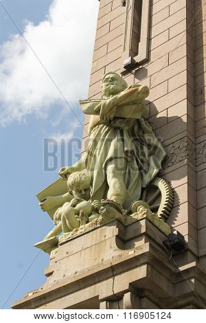 Statue Of Man And Child On Yeliseyev Grocery Store.