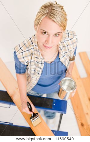 Home Improvement - Handywoman Painting Wooden Plank