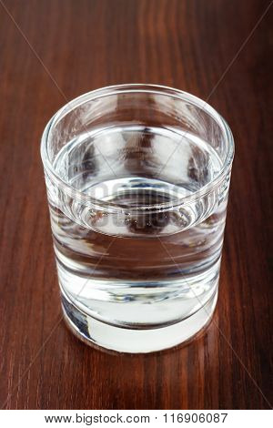 Glass Of Transparent Purified Water On Wooden Table