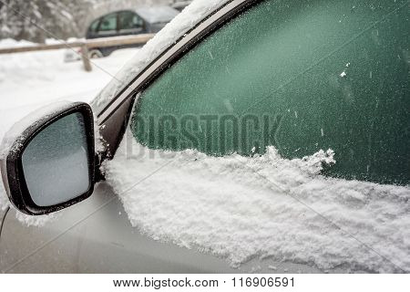 Car's Window Frozen And Car's Mirror Covered With Snow In The Winter Daydow Frozen And Cove