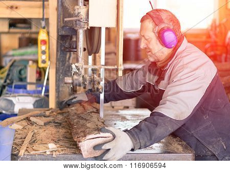 Strong Man Carpenter Using Table Saw For Cutting Wood At Workshop - Woodworker Working Hard