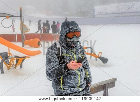 Man Standing Outdoor On The Snow And Fog on Smartphone