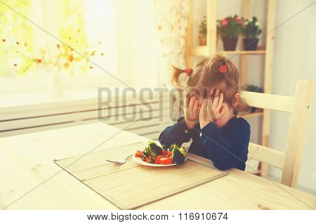 Child Girl Does Not Like And Not Want To Eat Vegetables