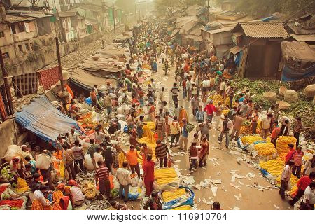 Crowd Of Busy People Buying Flowers At Mullik Ghat Flower Market On Indian Street