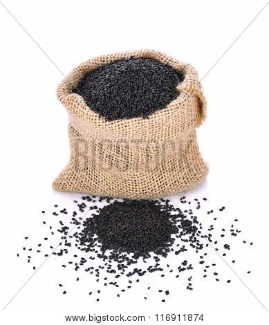 Black Sesame In Small Sack Is Isolated On White Background