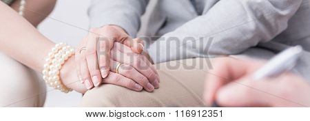 Man Holding Woman's Hand