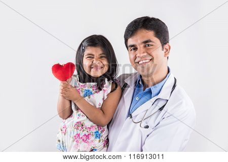 handsome pediatric doctor holding a baby girl, male doctor with small girl, indian doctor, indian gi