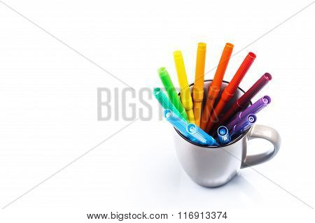 Color felt-tipped pens in a cup