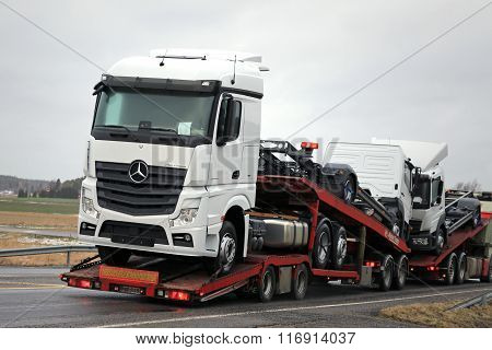 New Mercedes-Benz Trucks Being Hauled