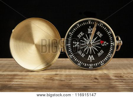 Compass On Wooden Table With Space For Text