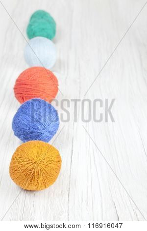 Yarn Balls On Wooden Background, Space For Text