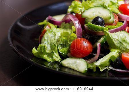 Vegetable salad with black olives