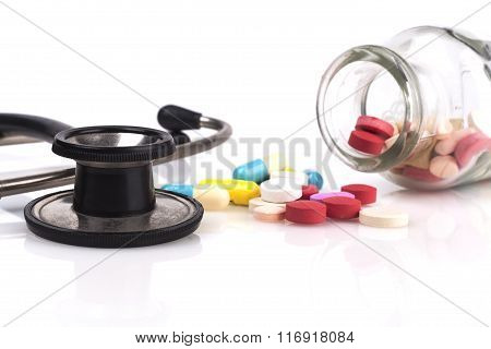 Stethoscope And Pills Jar