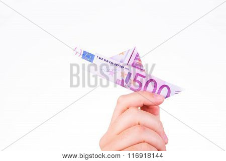 A Hand Holding A Paper Boat Made With A 500 Euro Note On White Background
