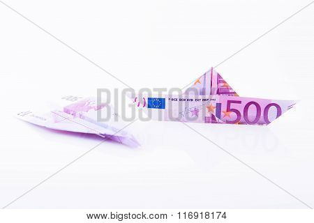 Boat And Paper Plane Made With A 500 Euro Note On White Background