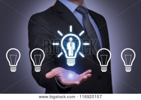 Businessman Holding his Hand Above the Human Resource Idea Bulb