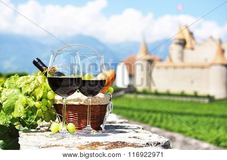 Wine, grapes and bread against an old castle. Switzerland