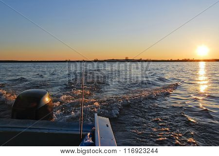 The boat ride on the river at sunset