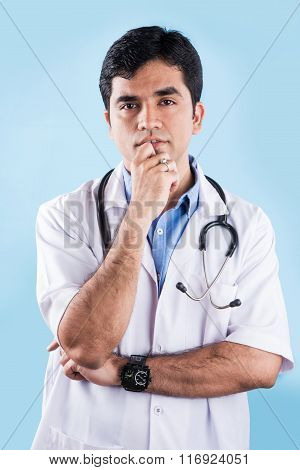 portrait of Thinking indian doctor, indian doctor thinking, asian doctor thinking, isolated on blue
