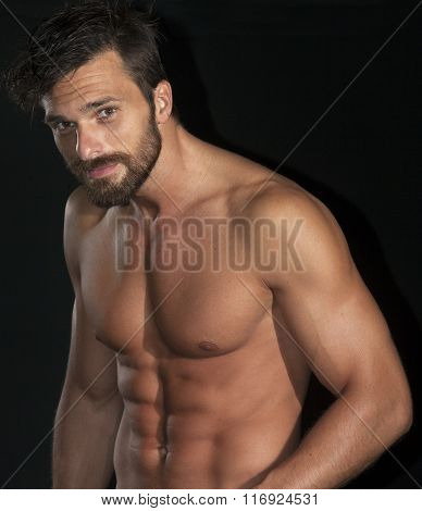 Handsome Muscular Body Man Isolated On Black