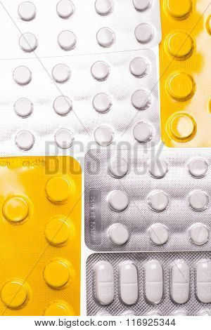 Blisters with pills on a white background for the treatment of diseases