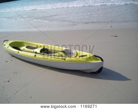 Single Yellow Canoe At Beach