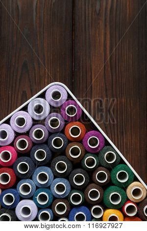 Spools Of Threads On The Wood Background