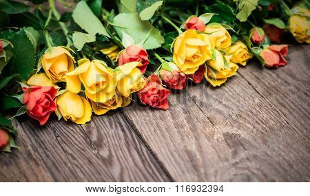 Yellow And Red Roses On A Wooden Background. Women' S Day, Valentines Day, Mothers Day