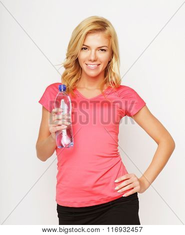 sporty woman with water bottle