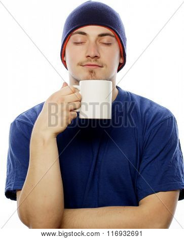 man holding white cup with coffee