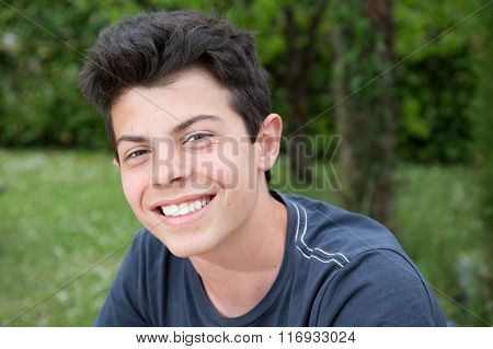 Closeup Portrait Of A Handsome Young Man Smiling