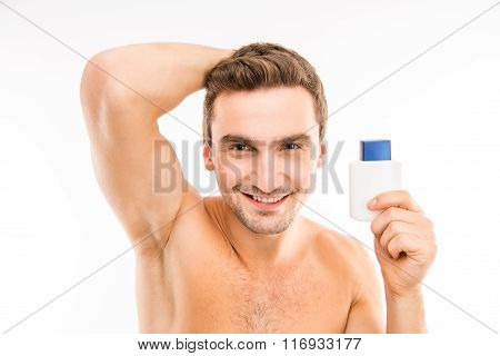 Portrait Of Young Muscular Man In Bathroom