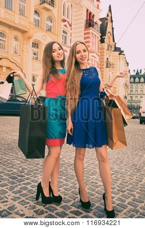 Beautiful Girls With Shopping Bags Walking On The Street