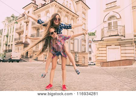 Funny Girls Traveling And  Fooling Around On The Street