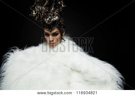 Woman in headwear and fur coat
