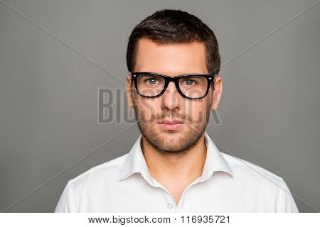 Portrait Of Serious Smart Man In Glasses