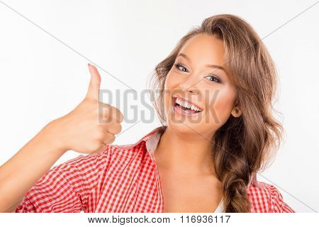 Happy Cute Girl Showing Thumb Up And Smiling