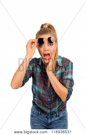 Funny Girl Surprised And Holding Her Glasses