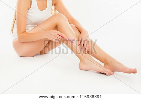 Closeup Photo Of Young Woman Shaving Her Leg