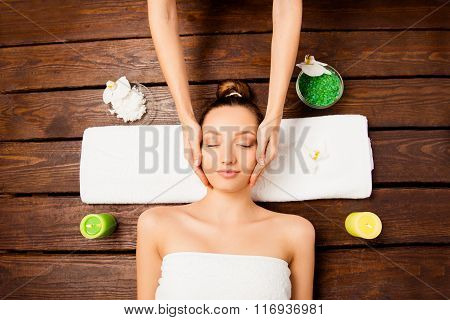 Attrative Young Girl Having Spa Procedures In Spa Salon, Top View Photo