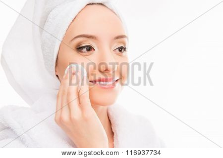 Pretty Girl With Towel On Her Head Wash Off Makeup, Close Up Photo