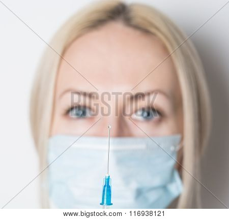Woman Doctor With Syringe