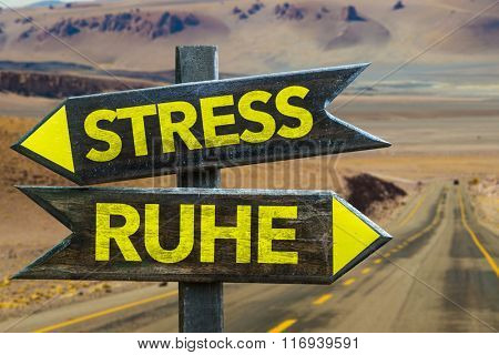 Stress - Peace (in German) signpost in a desert background