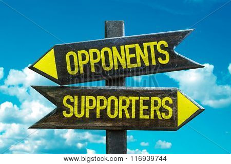 Opponents - Supporters signpost with sky background