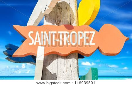 Saint-Tropez welcome sign with beach